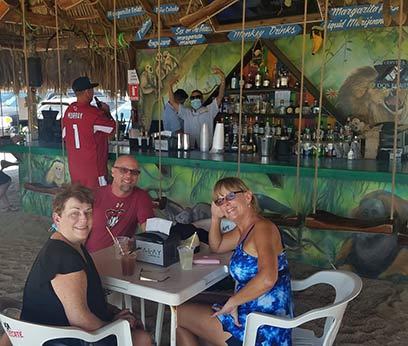 Patrons social distancing at bar in Rocky Point Mexico