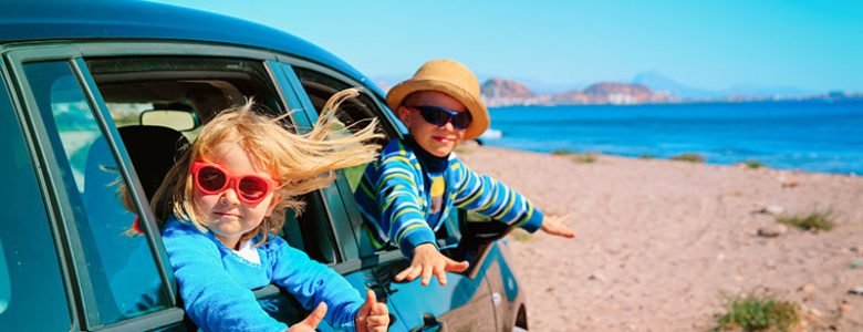 Kids in Car on Beach