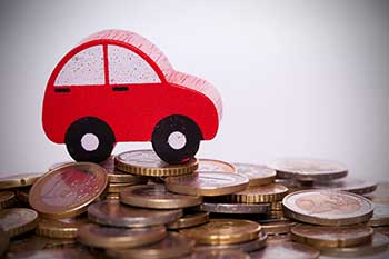 toy auto driving on pesos