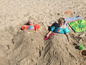 Kids Buried in Sand Mexico Beach