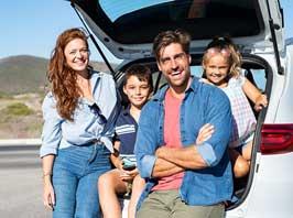 Family in back of car